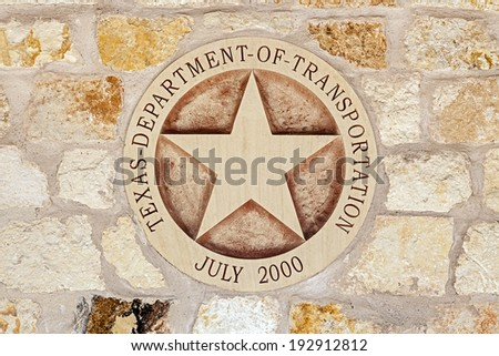 Texas Department of Transportation Symbol on the Sandstone Wall - stock photo