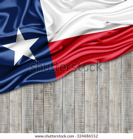 texas  flag of silk with copyspace for your text or images and wood background - stock photo