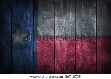 texas flag on old wooden wound - stock photo