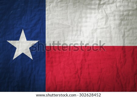 Texas flag painted on a Fabric creases,retro vintage style - stock photo