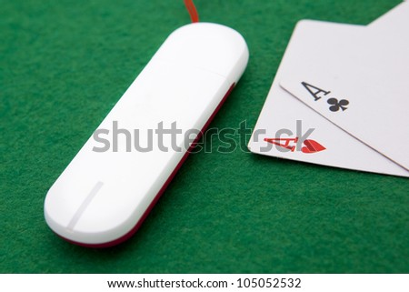 Texas holdem pocket aces on casino table with internet stick connection - stock photo