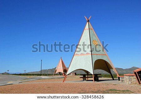 Texas Roadside Rest Area Picnic Tables with a Decorative TeePee Shelter - stock photo