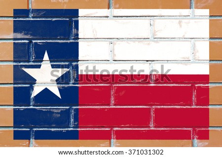Texas state flag of America on brick wall - stock photo