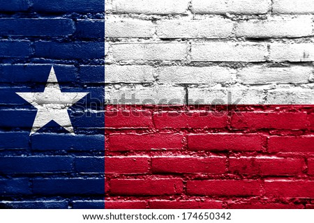 Texas State Flag painted on brick wall - stock photo