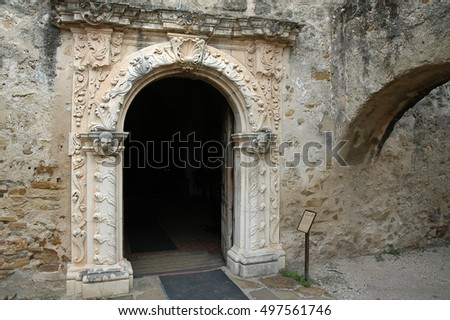 TEXAS, USA - SEPTEMBER 21, 2006: Bow with sculptural reliefs at the entrance to the chapel, Mission San Jose in San Antonio