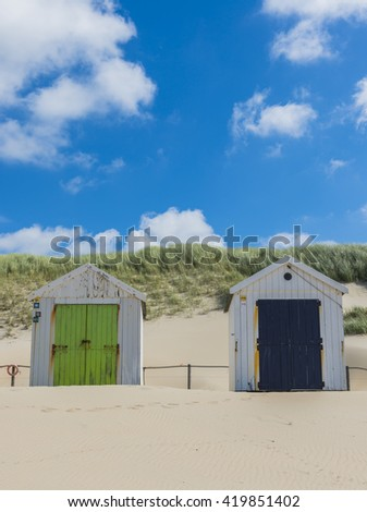 Texel, The Netherlands - August 23, 2012: Two cabins on the beach of the Wadden isle.