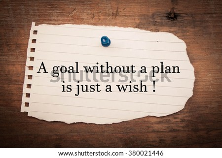 Text a goal without a plan is just a wish on note paper and wood  - stock photo