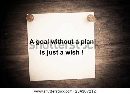 Text a goal without a plan is just a wish! on paper and wood - stock photo