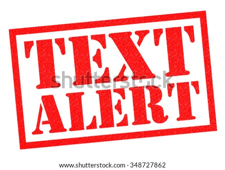 TEXT ALERT red Rubber Stamp over a white background.