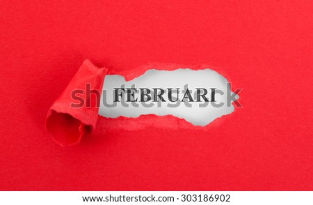 Text appearing behind torn red envelope - Februari
