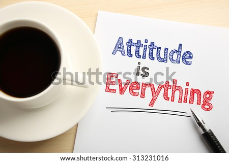 Text Attitude is Everything written on the white paper with pen and a cup of coffee aside. - stock photo
