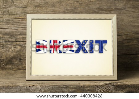 Text BREXIT in a wooden photo frame - stock photo