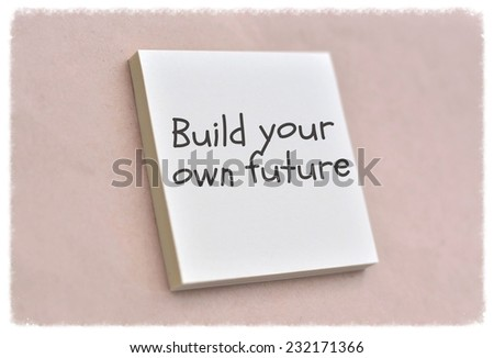 Text build your own future on the short note texture background - stock photo