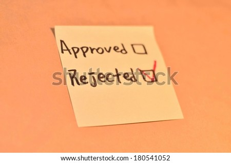 Text checked rejected and approved on the short note texture background