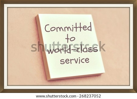 Text committed to world class service on the short note texture background - stock photo