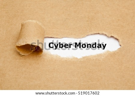 Text Cyber Monday appearing behind ripped brown paper.