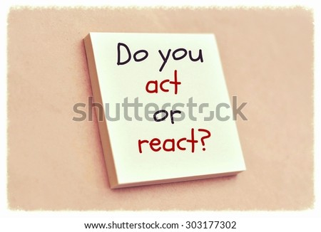 Text do you act or react on the short note texture background - stock photo