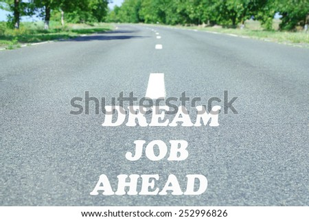 Text Dream Job Ahead marking on road surface - stock photo