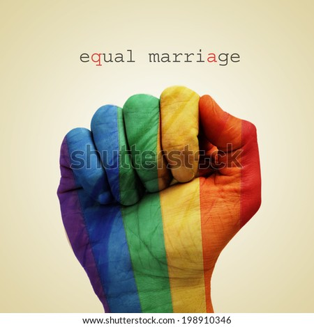 text equal marriage and a man hand patterned with the rainbow flag on a beige background - stock photo
