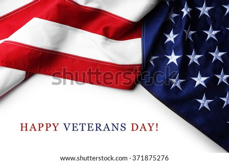 Text Happy Veterans Day on white background near American flag - stock photo