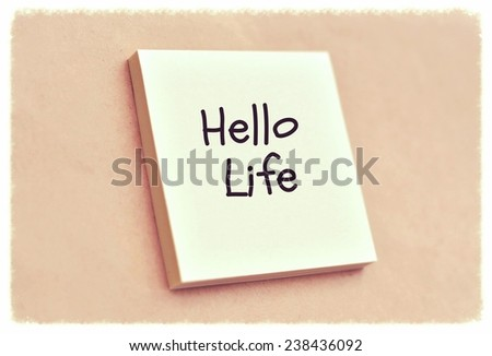 Text hello life on the short note texture background - stock photo