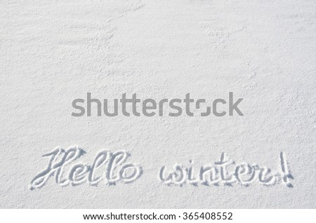Text HELLO WINTER hand written on snow background. Horizontal postcard template. Space for copy, lettering. - stock photo