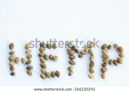 Text hemp made of cannabis seeds in a white background - stock photo
