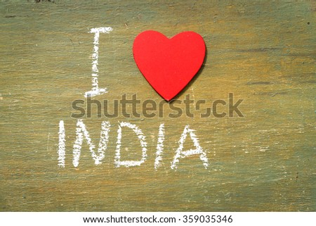 Text i love India written with chalk in old board wooden. - stock photo