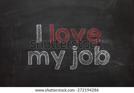 Text I love my job handwritten with white chalk on a blackboard - stock photo