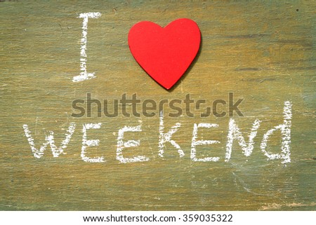 Text i love weekend written with chalk in old board wooden. - stock photo