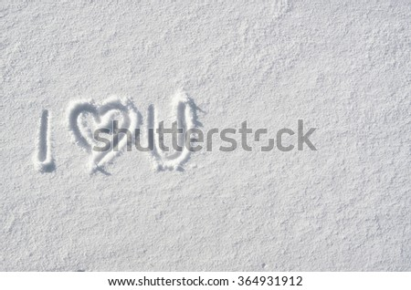 Text I LOVE YOU and heart hand written on snow background. Horizontal valentines postcard template. Space for copy, lettering. - stock photo