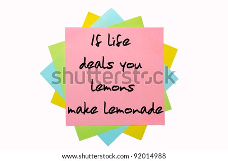 "text "" If life deals you lemons, make lemonade "" written by hand font on bunch of colored sticky notes"