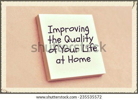 Text improving the quality of your life at home on the short note texture background - stock photo
