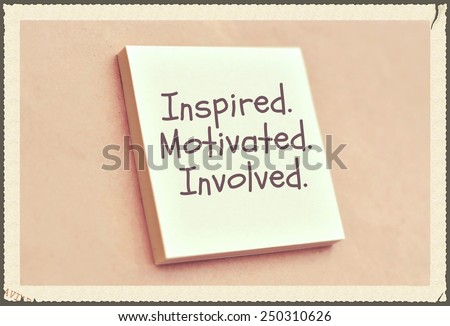 Text inspired motivated involved on the short note texture background - stock photo