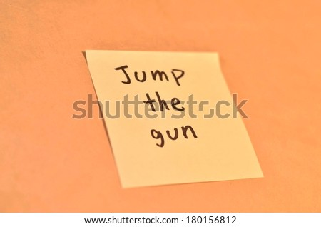 Text jump the gun on the short note texture background - stock photo