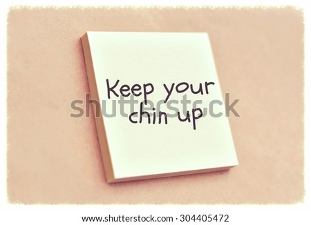 Text keep your chin up on the short note texture background - stock photo