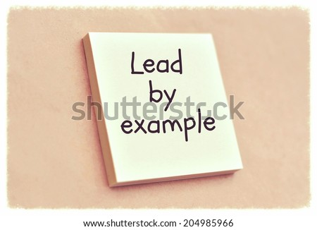 Text lead by example on the short note texture background - stock photo