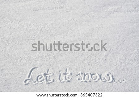 Text Let it snow hand written on snow background. Horizontal postcard template. Space for copy, lettering. - stock photo