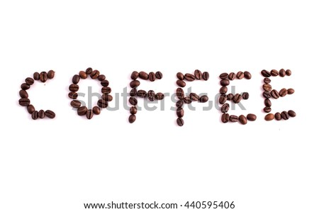 Text made of coffee beans: COFFEE. Texture of the coffee beans on a white background. Smelly, saturated brown arabic coffee beans - stock photo