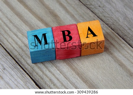 text MBA ( Master of Business Administration) on colorful wooden - stock photo