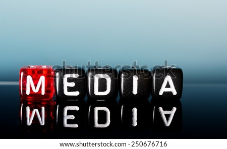 text  Media on red and  black    dices on  blue background - stock photo
