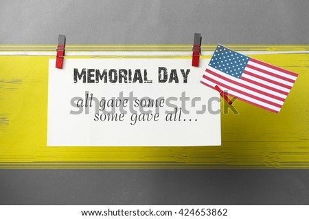 Text Memorial Day on American flag background. honoring card concept