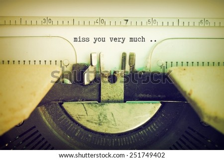 text  miss you very much on the vintage typewriter in vintage color - stock photo