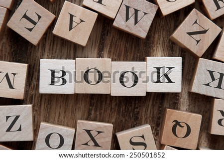 text of BOOK on cubes - stock photo