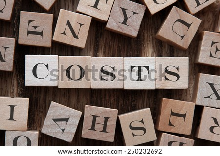 text of COSTS on cubes - stock photo