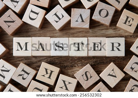 text of MASTER on cubes - stock photo