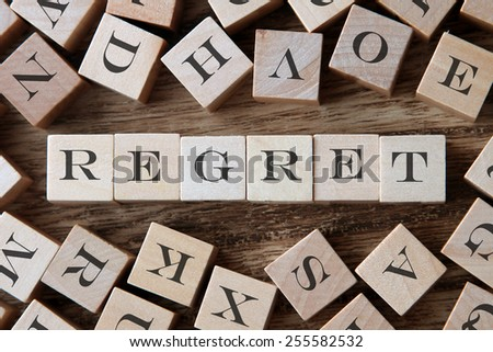 text of REGRET on cubes - stock photo