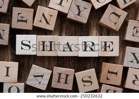 text of SHARE on cubes - stock photo