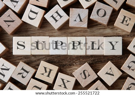 text of SUPPLY on cubes - stock photo