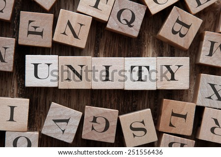 text of UNITY on cubes - stock photo